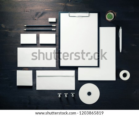 Blank stationery set on wood table background. Corporate identity template. Mock-up for branding identity for designers. Top view. Flat lay.