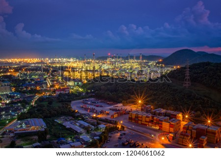 Petrochemical oil refinery plant with chemical tank and equipment pipeline near seaport at the night light cityscape around urban  #1204061062