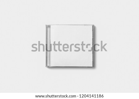 Closed compact plastic disc box case with white isolated blank for branding design. CD jewel mock-up on soft gray background. #1204141186