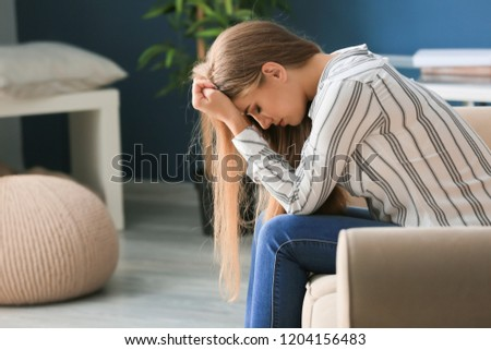 Lonely woman suffering from depression at home #1204156483