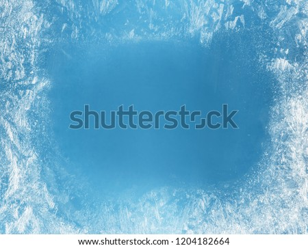 Frost patterns on frozen window as a symbol of Christmas wonder. Christmas or New year background. #1204182664
