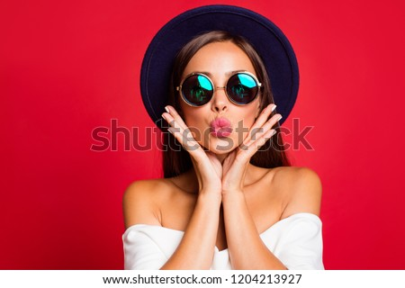 Close-up portrait of nice cool bright vivid attractive sweet lovely positive lady wearing white off-the-shoulders ruffles top blouse sending kiss holding cheeks in palms isolated over red background #1204213927