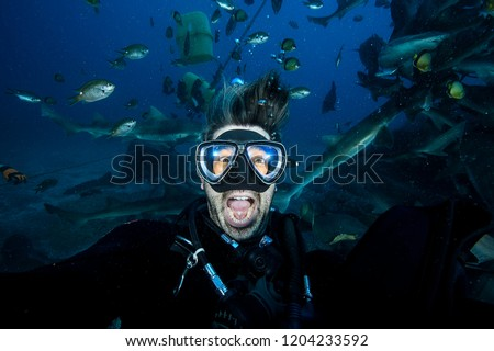 Panicking and Scared Scuba Diver with Mouth Wide Open Underwater Royalty-Free Stock Photo #1204233592