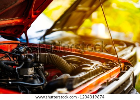 Car crash open hood car mechanic to check condition of damage. See the radiator cooling panel Engine and electronic system for mechanic to check damage thoroughly to repair engine to complete for use. #1204319674