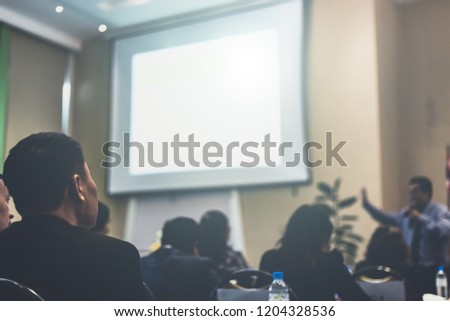 Speaker giving a talk at business meeting. audience in the conference hall. Business and entrepreneurship. copy space on white board. #1204328536