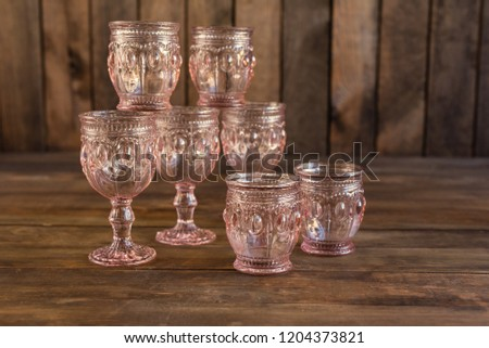 Beautiful glasses on a dark wooden background #1204373821