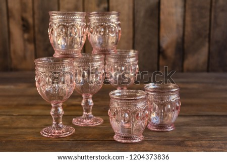 Beautiful glasses on a dark wooden background #1204373836