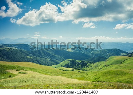summer mountains green grass and blue sky landscape #120441409