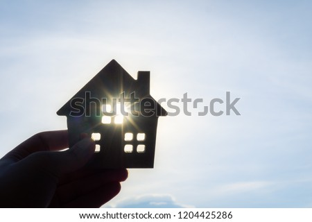 House model in home insurance broker agent 's hand or in salesman person. Real estate agent offer house, property insurance and security, affordable housing concepts #1204425286