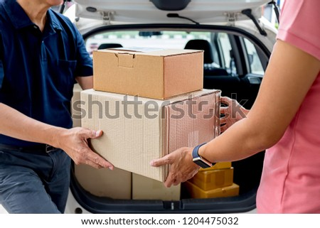 Delivery service courier driver driving with with boxes in hands. Delivery concept. #1204475032