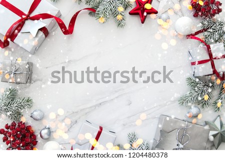 Christmas silver handmade gift boxes on white marble background top view. Merry Christmas greeting card, frame. Winter xmas holiday theme. Happy New Year. Flat lay #1204480378