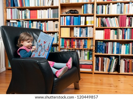 Child with book in armchair