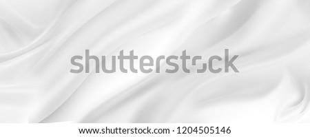 Closeup of rippled white silk fabric Royalty-Free Stock Photo #1204505146