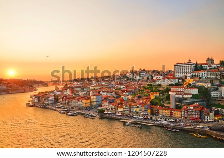 Magnificent sunset over the Porto city center and the Douro river, Portugal. Dom Luis I Bridge is a popular tourist spot as it offers such a beautiful view over the area.  Royalty-Free Stock Photo #1204507228