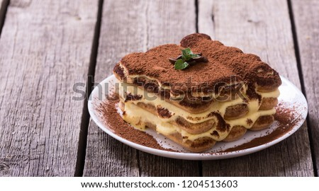 Homemade tiramisu cake . Sweet Italian dessert . Food background #1204513603