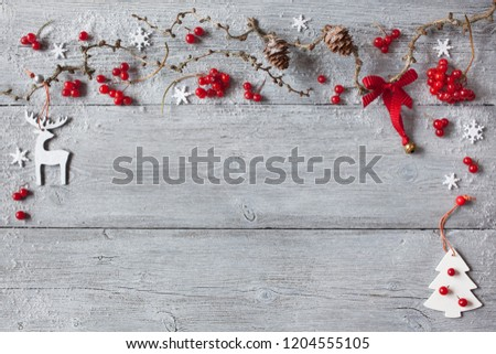 Christmas wood background, twigs, cones, red berries and reindeer #1204555105