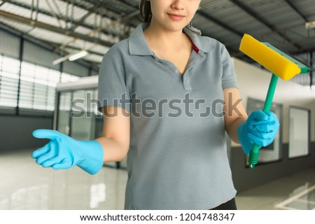 Female cleaning staff in bathroom blurred background Metaphor for 