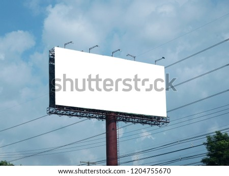 Blank billboard on blue sky background for new advertisement #1204755670