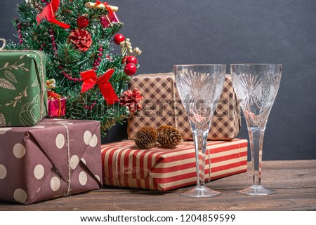 Varied and bright gifts under a Christmas tree on a black background #1204859599