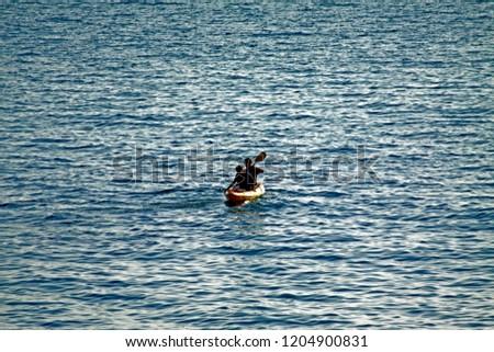 The kayak on the golden sea #1204900831