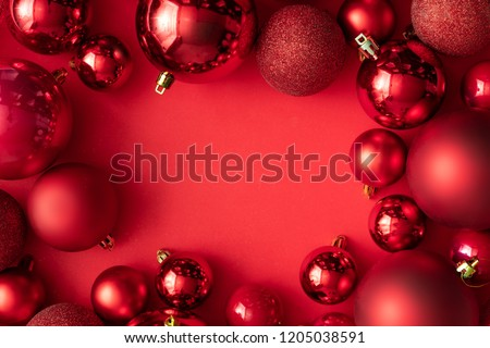 Red Christmas baubles decoration on red background with copy space. New Year greeting card. Minimal style.  Flat lay. #1205038591