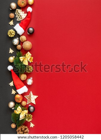 Christmas decoration background red with santa hats glass balls twig apples nuts #1205058442