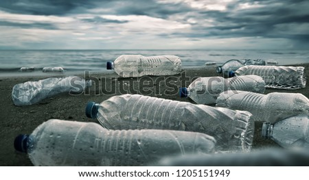Plastic water bottles pollution in ocean (Environment concept) Royalty-Free Stock Photo #1205151949