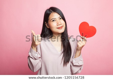 Asian woman thumbs up with red heart on pink background #1205156728