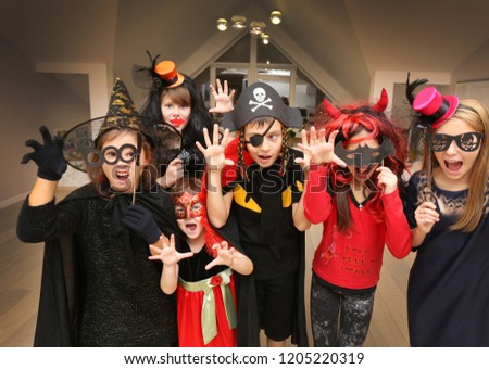 group of funny  children in costume celebrate together a halloween party #1205220319