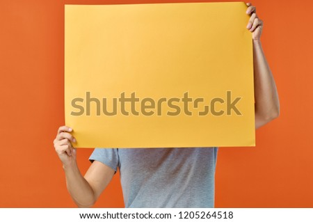 man covers his face with yellow mockup                       #1205264518