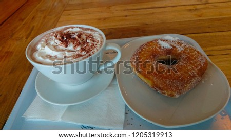 Coffee with cream and a sugary delicacy #1205319913