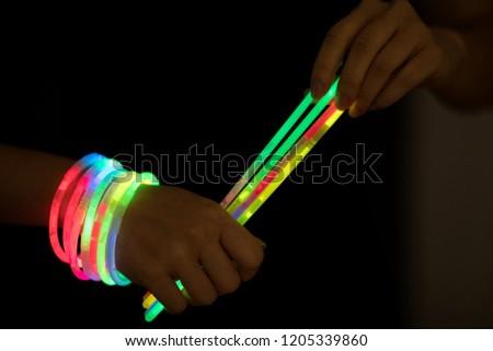 glow sticks with hands #1205339860