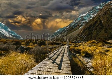 Pedestrian walkway with sunset background #1205576668