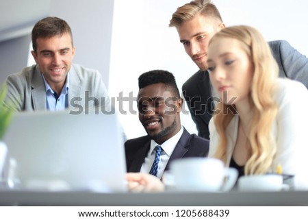Business people in discussing something while sitting together at the table #1205688439