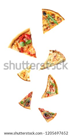 Set with falling different pizza slices on white background #1205697652