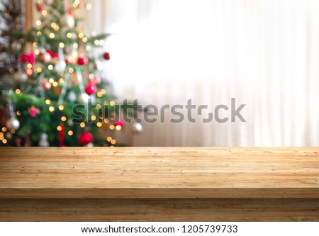 empty wood table top and blur of room with a christmas tree background, suitable for montage product display. #1205739733