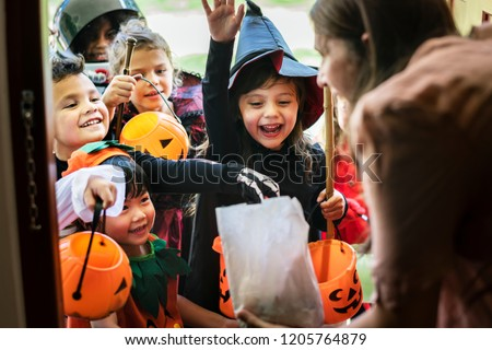 Little children trick or treating on Halloween #1205764879