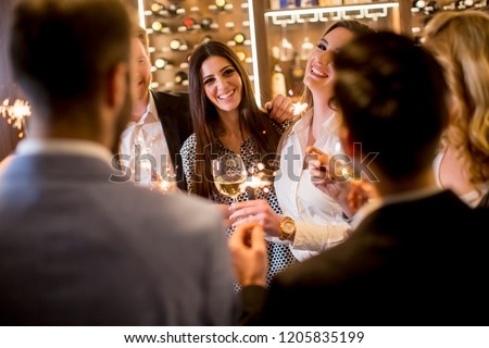 Group of young people toasting with white wine at home #1205835199