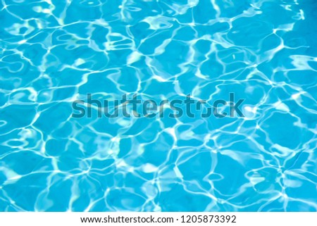 Blue water in swimming pool background #1205873392