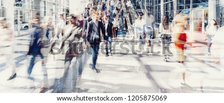 Crowd of anonymous people walking on busy city street Royalty-Free Stock Photo #1205875069