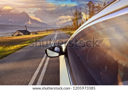 Driving a car in the mountains #1205973385