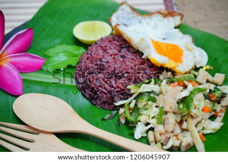 Basil Fried Chicken with rice berries and fried egg. #1206045907