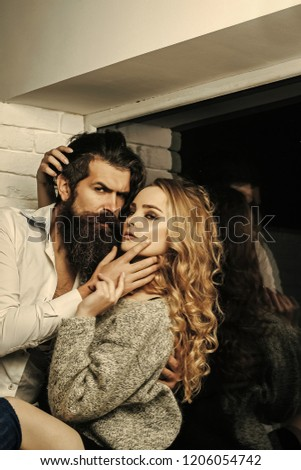 Woman with long hair and man with beard at window. Couple in love hug. Intimacy, passion, foreplay. Flirt, relationship, romance. Desire, sensuality seduction concept #1206054742
