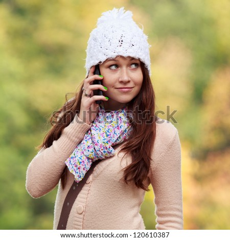 Cute Smiling Girl listening to mobile phone. European Young Teenager Girl. Girl with mobile phone. #120610387