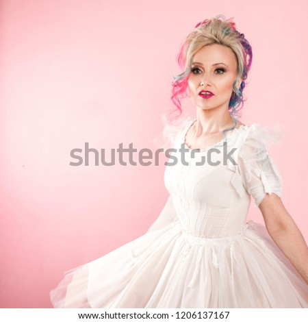 Cool young woman with colored hair. Stylish hairstyle, informal style. Pink background #1206137167