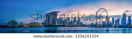 SINGAPORE - JULY 9, 2016 : Singapore Skyline and view of skyscrapers on Marina Bay at twilight time. #1206241324
