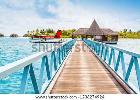 South Ari Atoll, Dhidhoofinolhu, Maldives - 4 July 2017: Overwater wooden pier for boats and seaplanes,  Maldives, 4 July 2017 #1206274924