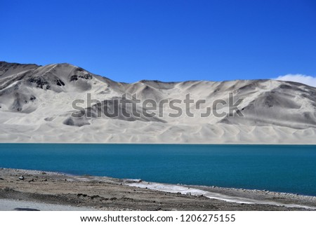 Sand dunes and turquoise blue water at Bulunkou lake on Karakoram Highway, Xinjiang #1206275155