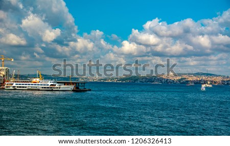 Beautiful View touristic landmarks from sea voyage on Bosphorus. Cityscape of Istanbul at sunset - old mosque and turkish steamboats, view on Golden Horn. #1206326413