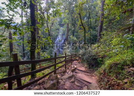 VALLE DE BRAVO, MEXICO. AUGUST 2018: Trailhead in front of waterfall. #1206437527